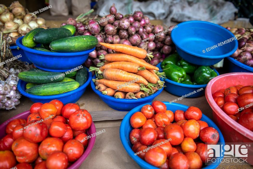Stock Photo: Plastic bins full of various vegetables for sale at outdoor market, Rwanda Farmers Market, in Rwanda.