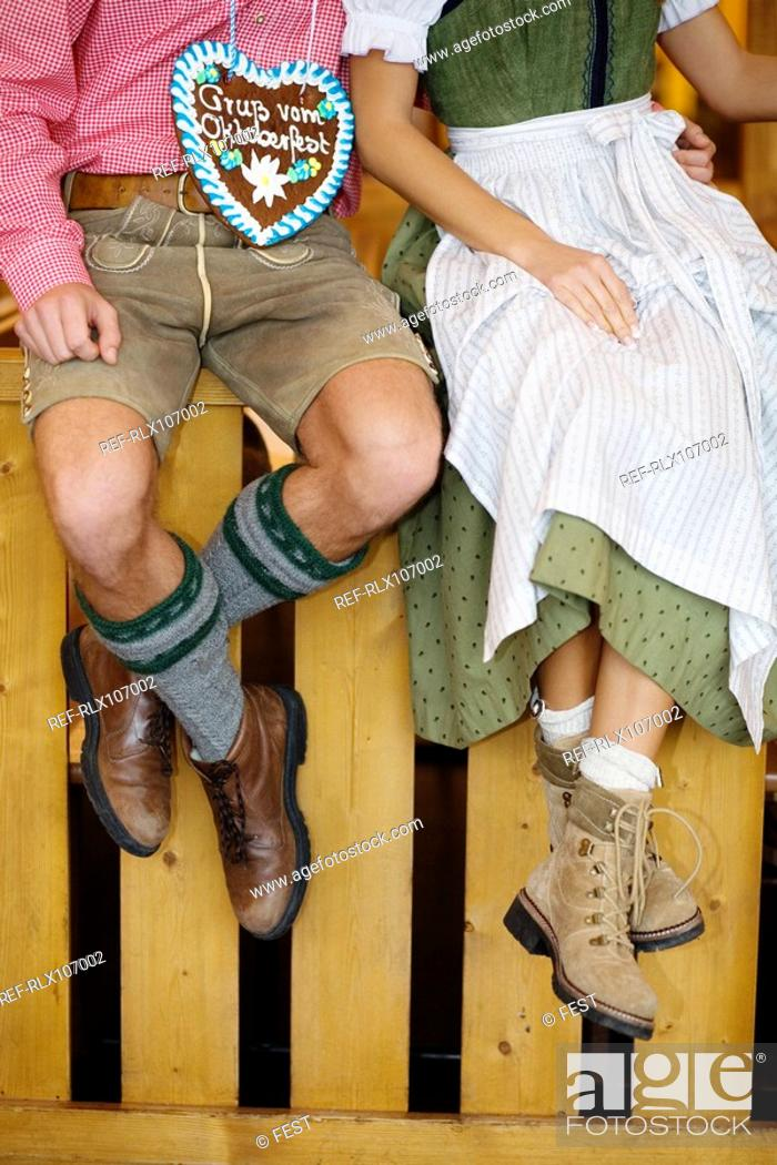 Stock Photo: Detail of young couple in Bavarian costume at Oktoberfest, Munich, Germany.