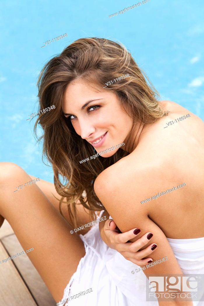 Stock Photo: Portrait of a blond woman in the pool smiling at camera.