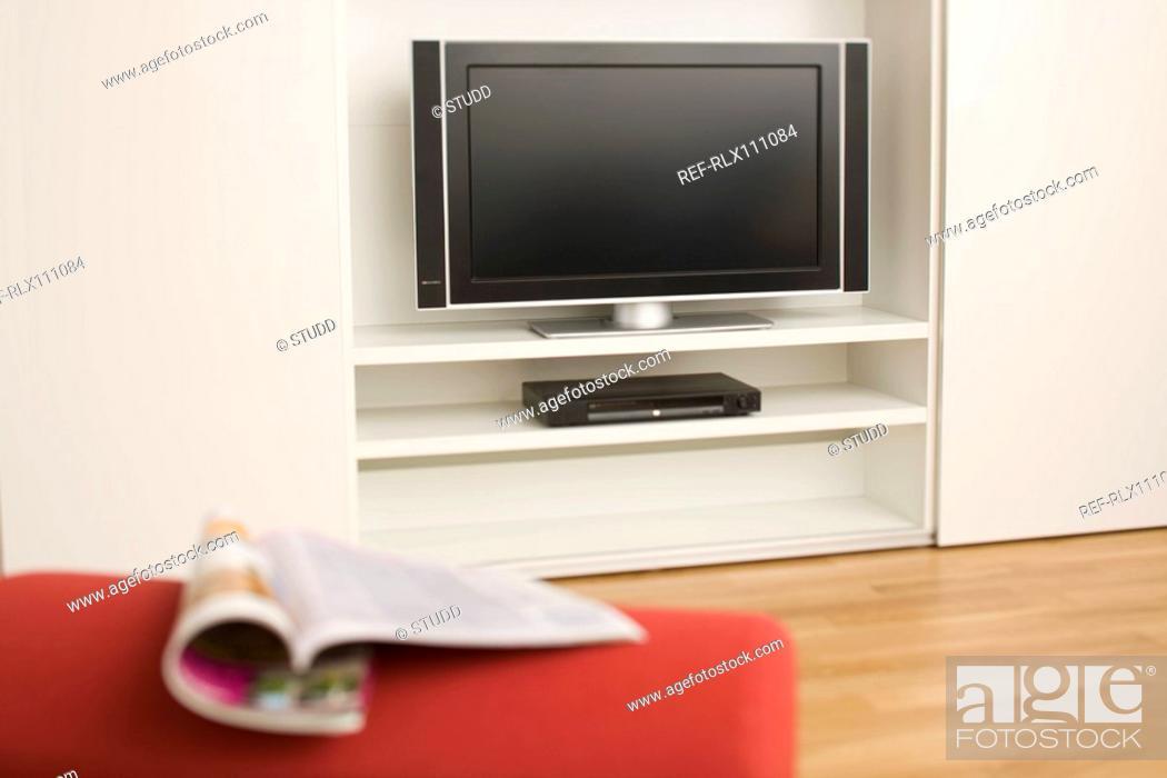 Stock Photo: Flat screen TV and magazine.