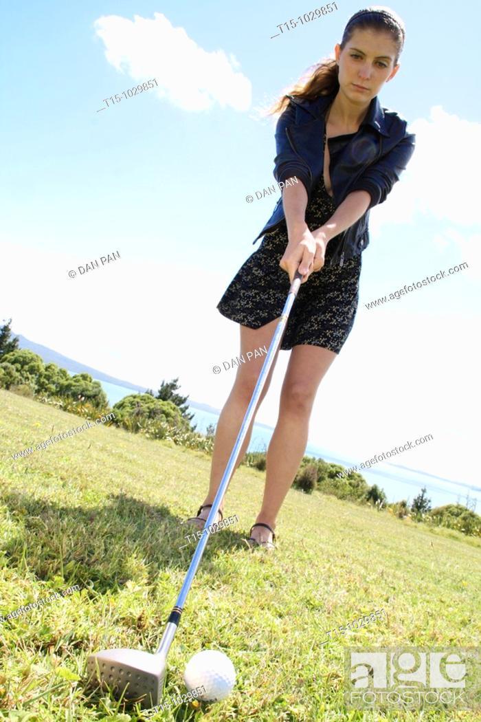 Stock Photo: woman teeing off.