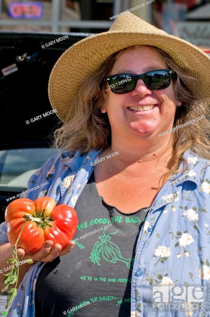Stock Photo: Woman farmer at farmers' market, downtown Arcata, California.