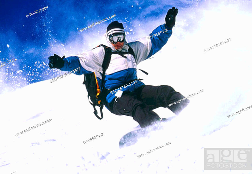Stock Photo: Low angle view of a man snowboarding.
