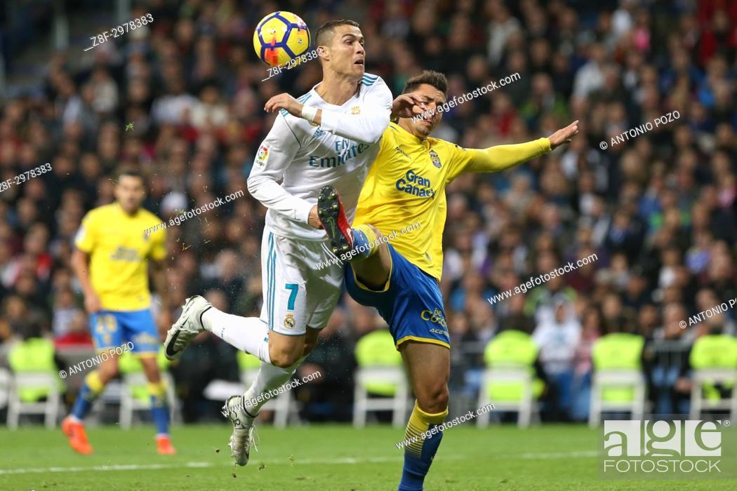 Stock Photo: MADRID, SPAIN. November 05, 2017 - Ximo Navarro and Cristiano Ronaldo. Real Madrid defeated Las Palmas 3-0 with an spectacular goal from Asensio with Casemiro.
