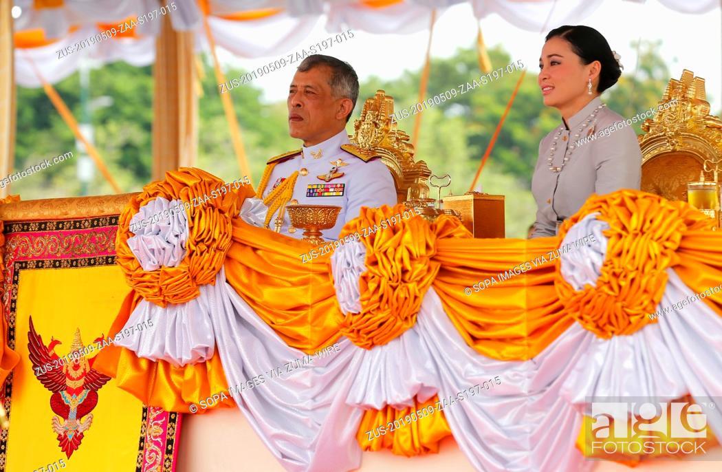 Stock Photo: May 9, 2019 - Bangkok, Thailand - Thailand's King Maha Vajiralongkorn Bodindradebayavarangkun (Rama X) and Queen Suthida watches the annual Royal Ploughing.