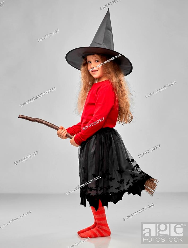 Stock Photo: girl in black witch hat with broom on halloween.