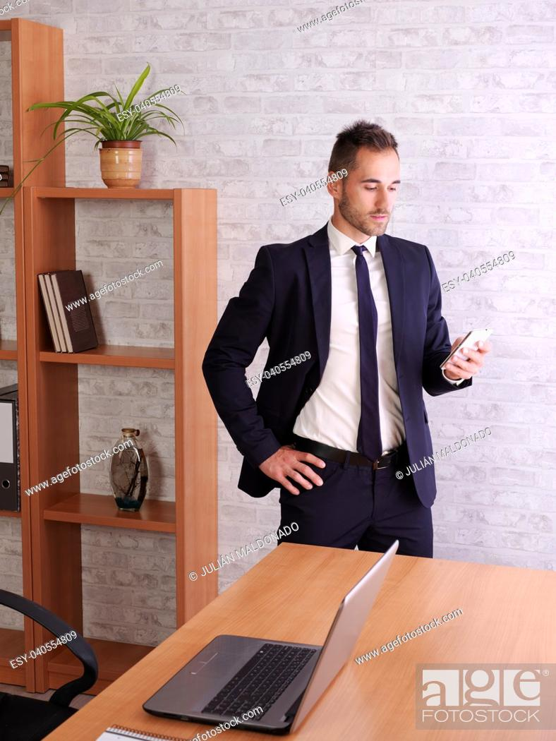 Stock Photo: Businessman communicating with the cell phone.