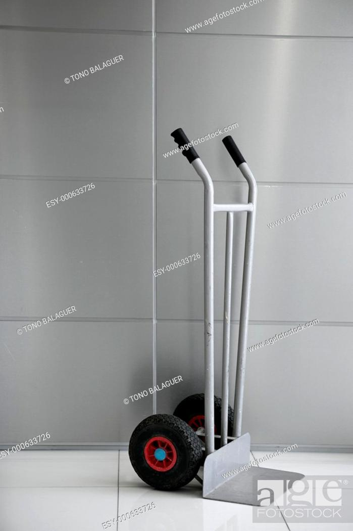 Stock Photo: boxes barrow vertical trolley silver gray background.