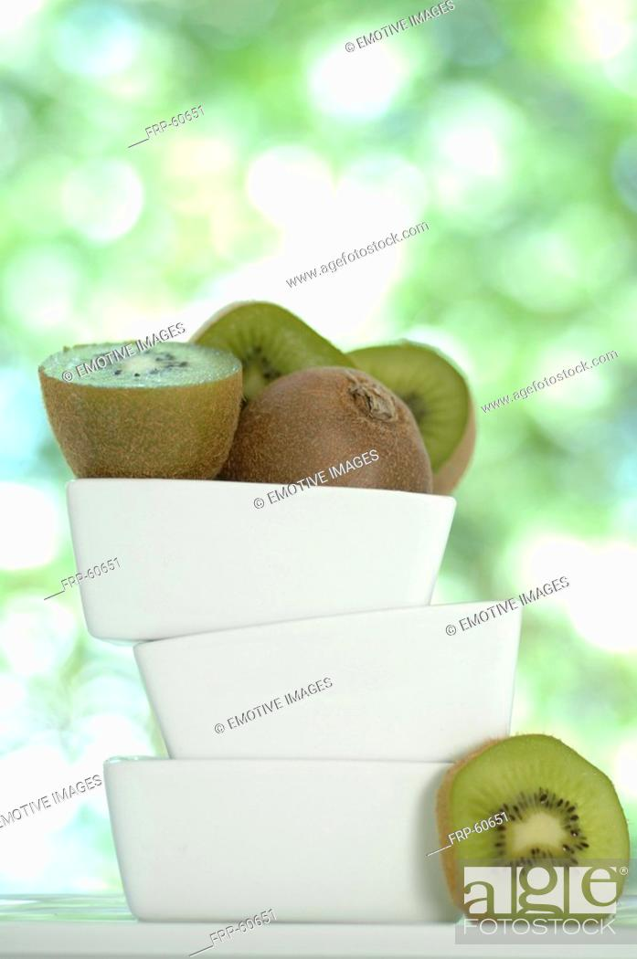 Stock Photo: Kiwi fruits in a stack of white bowls.