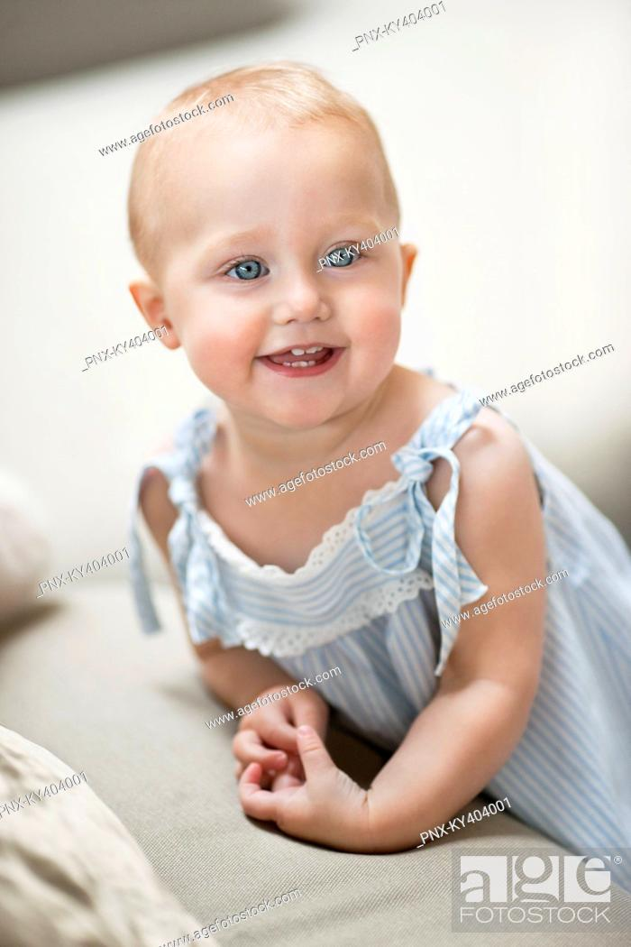 Stock Photo: Close-up of a baby girl smiling.
