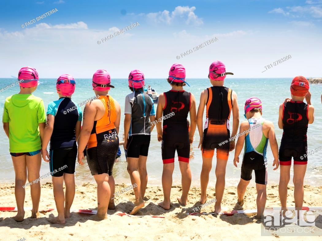 Stock Photo: guys ready for swimming race on the beach. in Alicante.