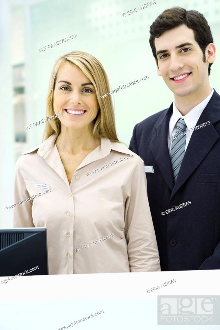 Stock Photo: Two professionals smiling at camera, portrait.
