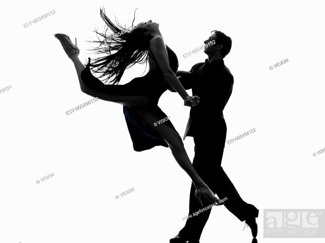 Stock Photo: one caucasian couple man woman ballroom dancers tangoing in silhouette studio isolated on white background.