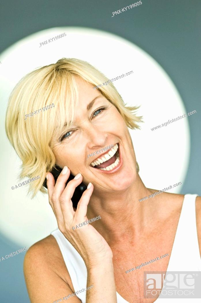 Stock Photo: Woman talking on a mobile phone and laughing.