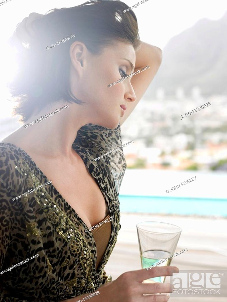 Stock Photo: Woman with champagne glass outdoors near mountains.