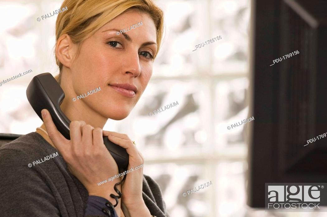 Stock Photo: Businesswoman on telephone.