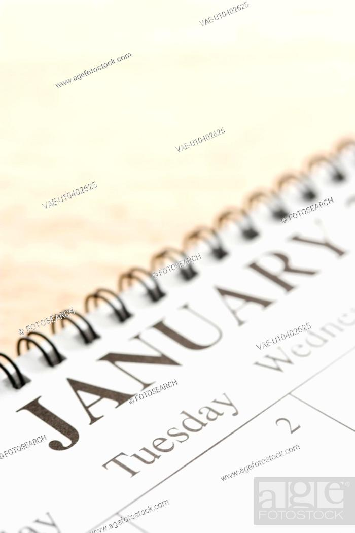 Stock Photo: Close up of spiral bound calendar displaying month of January.