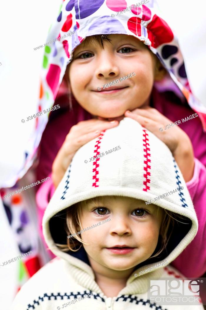 Stock Photo: Portrait of smiling girls, studio shot.