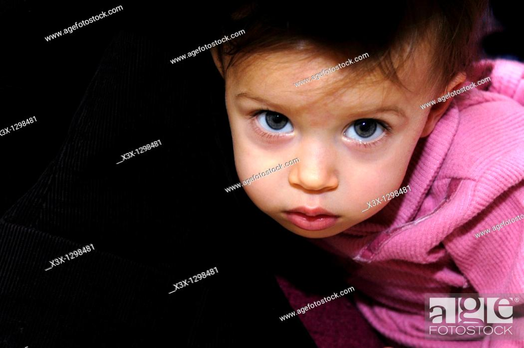 Stock Photo: Small female child looking straight back.