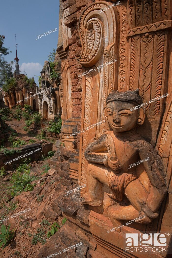 Stock Photo: A Hindu figure is a decorative element on one of the hundreds of stupas at Indein near Inle Lake.