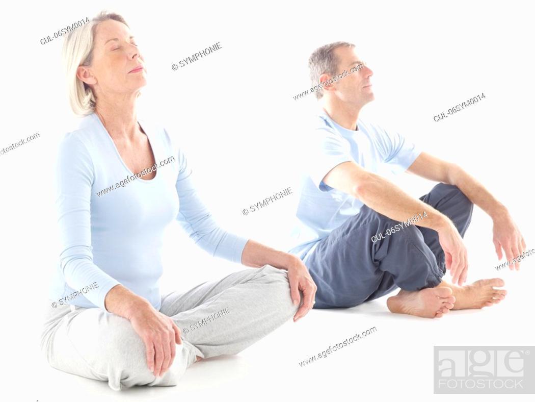 Stock Photo: Mature couple doing yoga.