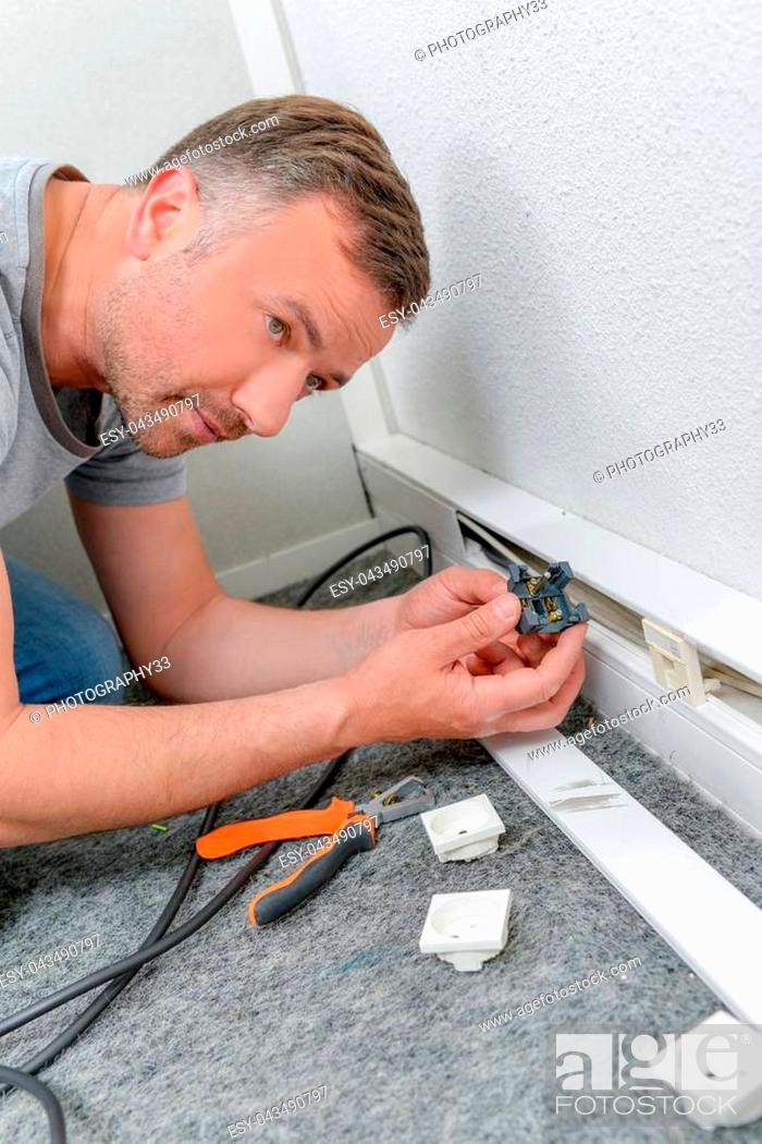 Stock Photo: Replacing a broken wall socket.