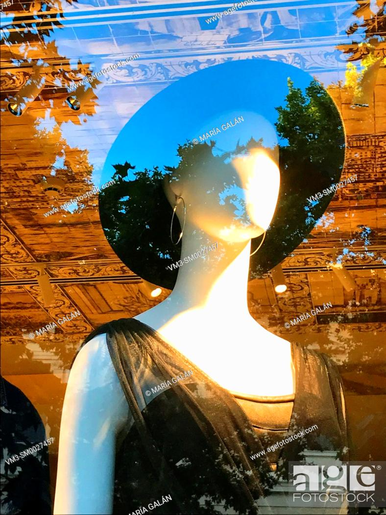 Stock Photo: Mannequin wearing black dress and hat in a shop window. Madrid, Spain.
