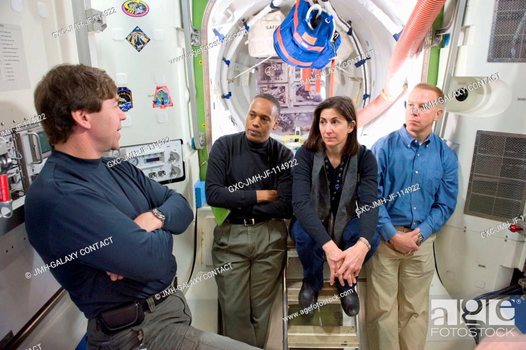 Stock Photo: NASA astronauts Michael Barratt (left), Alvin Drew, Nicole Stott and Tim Kopra, all STS-133 mission specialists, participate in a training session in an.