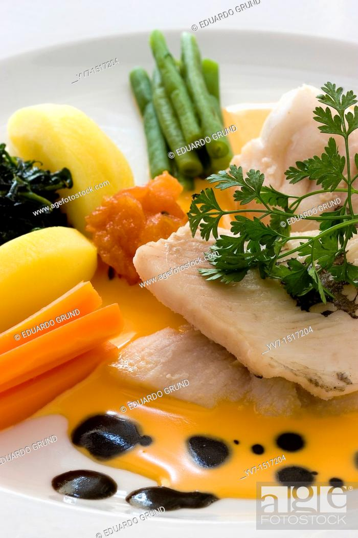 Stock Photo: Boiled fish with vegetables and squid sauce.