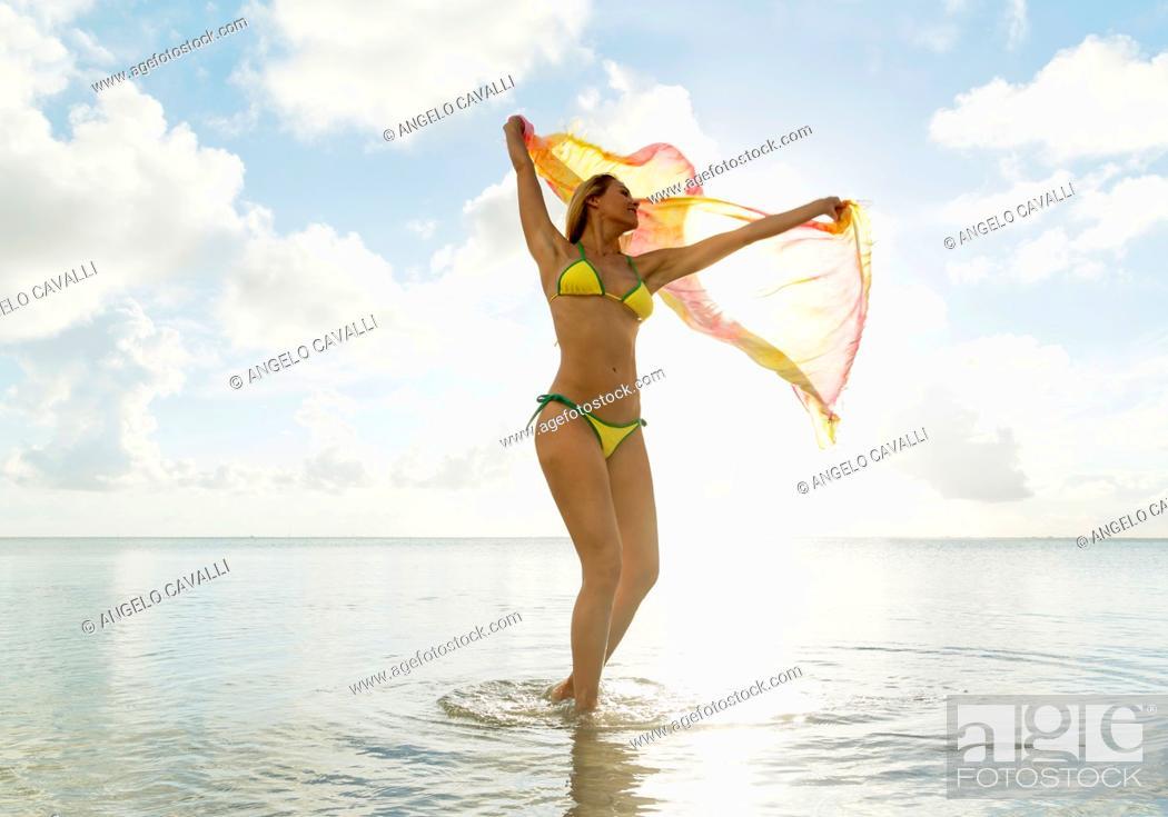 Stock Photo: Young woman on the beach, Miami Beach, Florida, USA.
