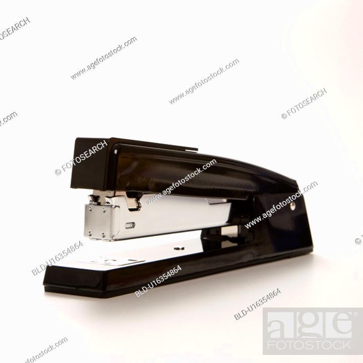 Stock Photo: Black stapler on white background.