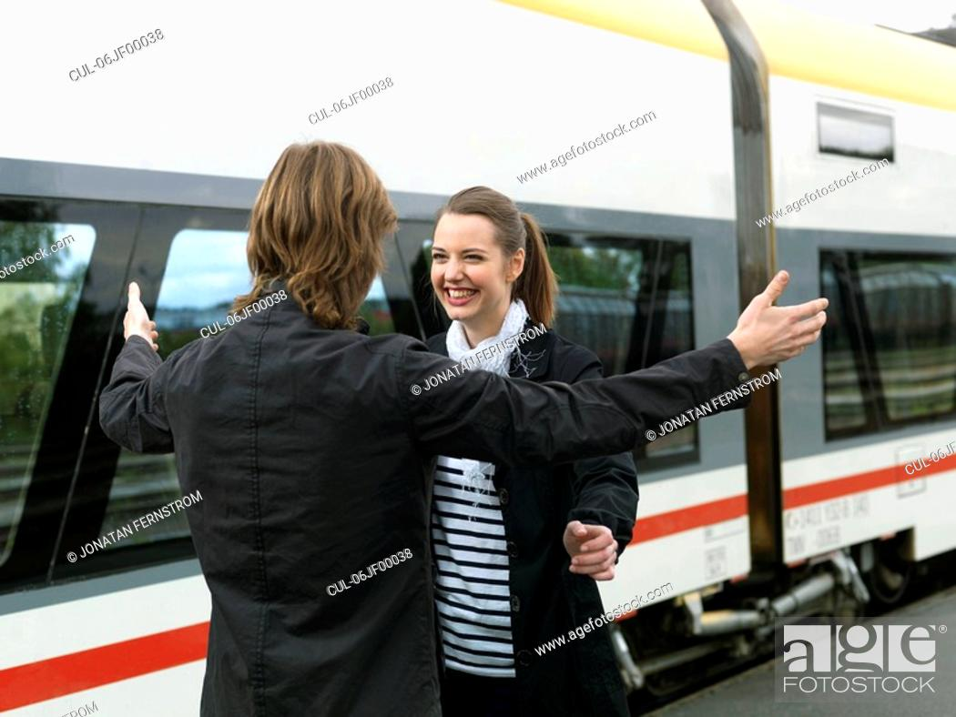 Stock Photo: Young couple on train station.
