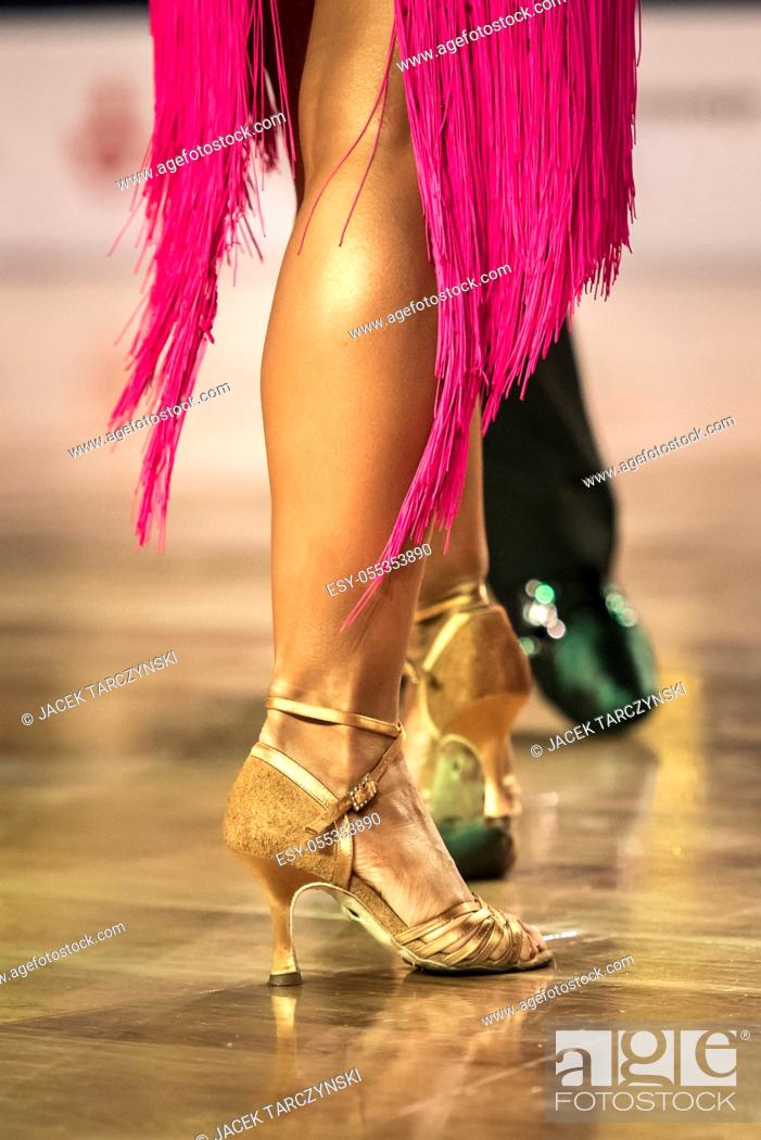Stock Photo: Beautiful womanish and masculine legs in active ballroom dance, indoors.