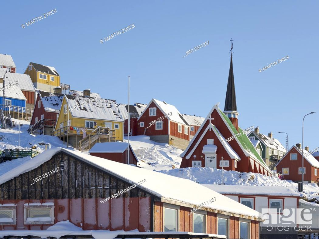 Stock Photo: The new church. Winter in the town of Upernavik in the north of Greenland at the shore of Baffin Bay. America , Denmark, Greenland.