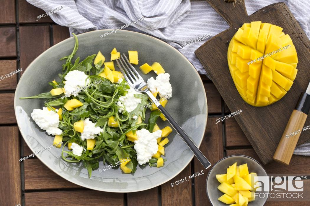 Stock Photo: Rocket salad with mango and cottage cheese.