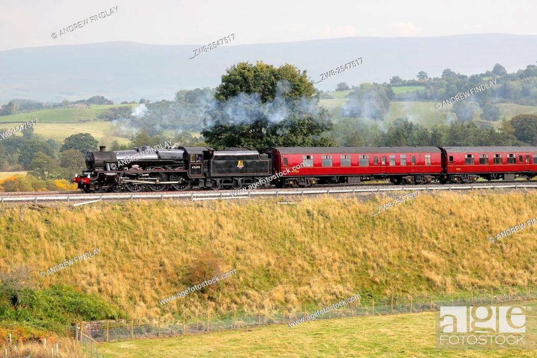 Stock Photo: Steam locomotive LMS Jubilee Class Leander 45690 on the Settle to Carlisle Railway Line near Lazonby, Eden Valley, Cumbria, England, UK.