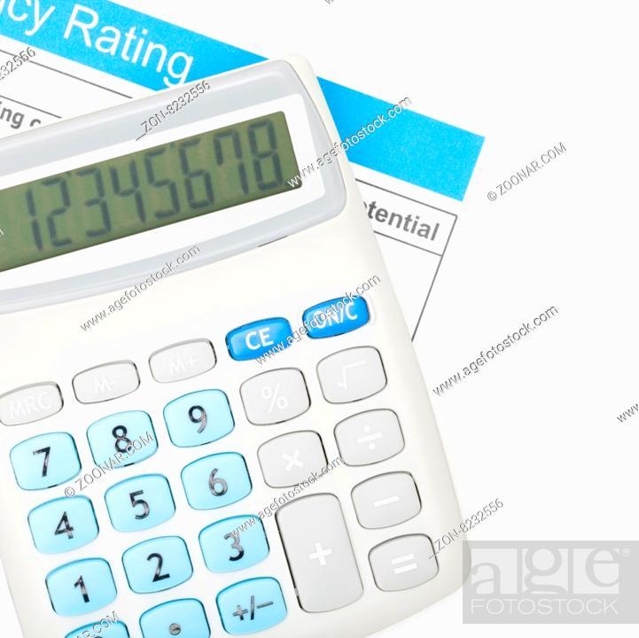 Imagen: Calculator over energy efficiency chart.
