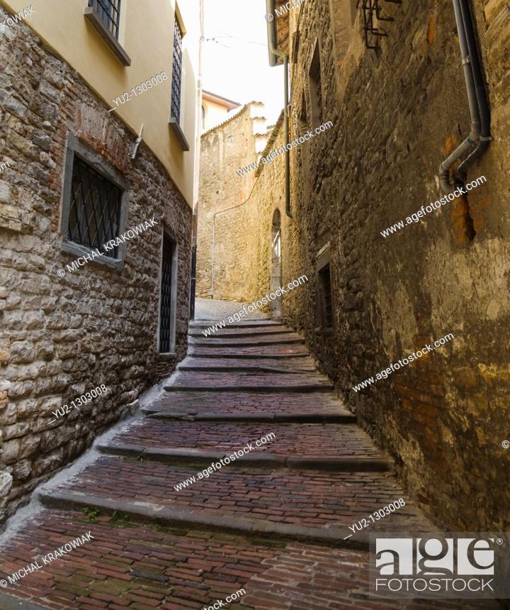 Stock Photo: Narrow alley between buildings in Bergamo, Italy.