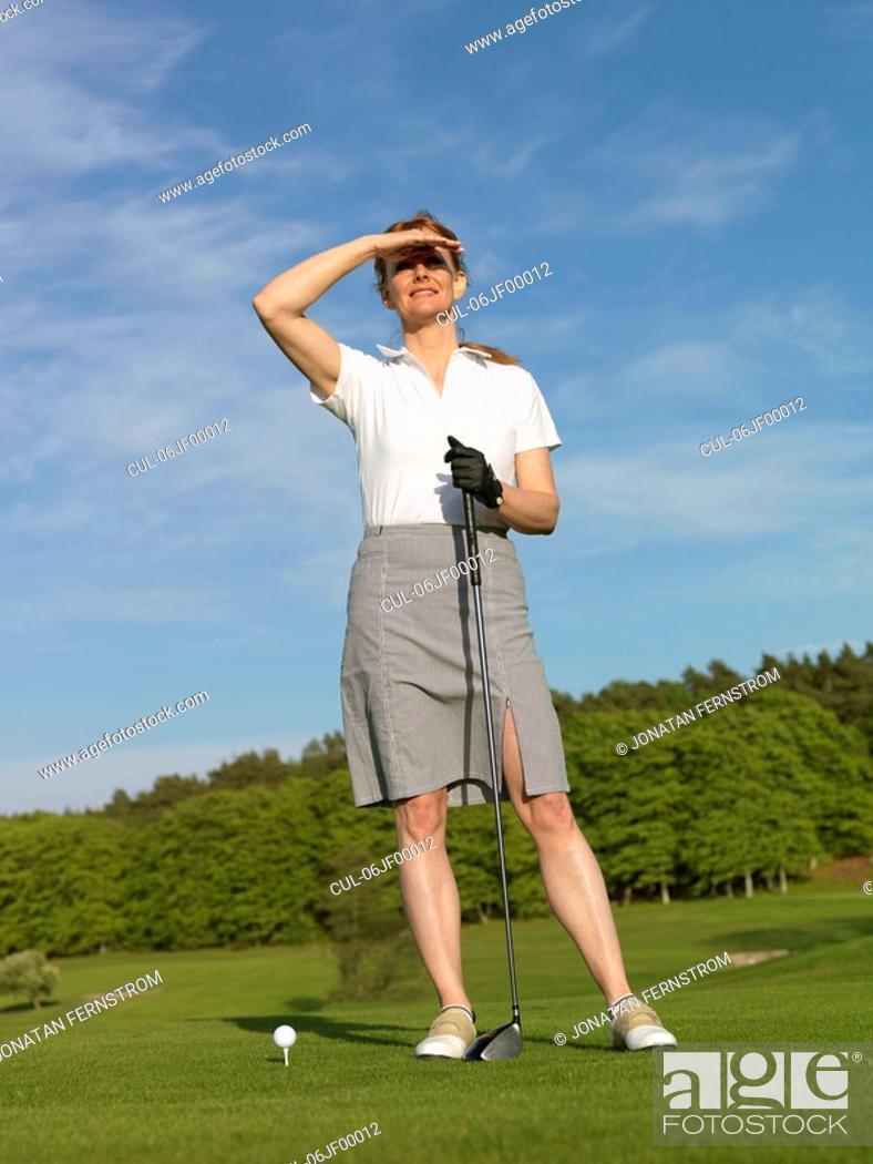 Stock Photo: Woman at golf tee.