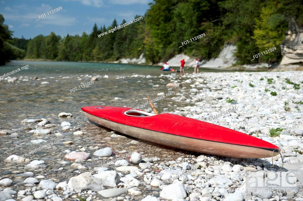Stock Photo: A kayak on a rocky beach.