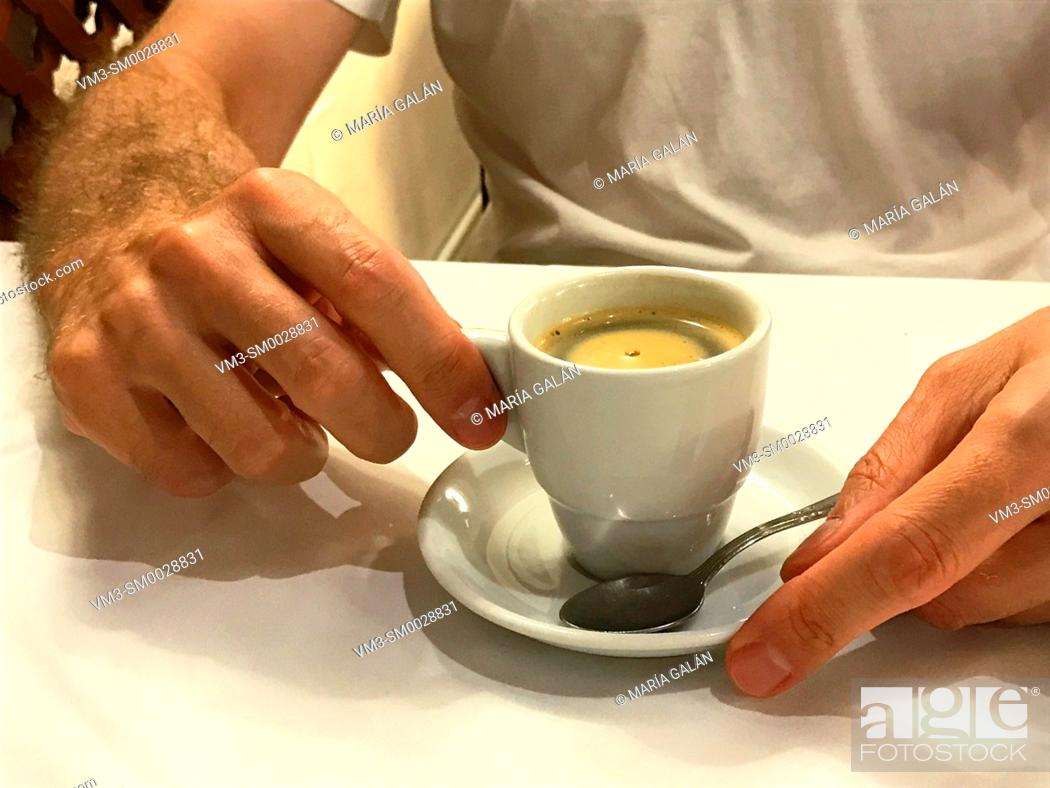 Stock Photo: Man drinking a cup of coffee.
