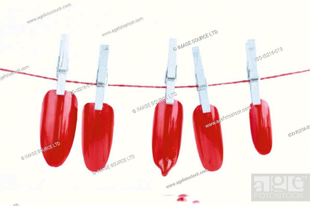 Stock Photo: Drying imitation nails.