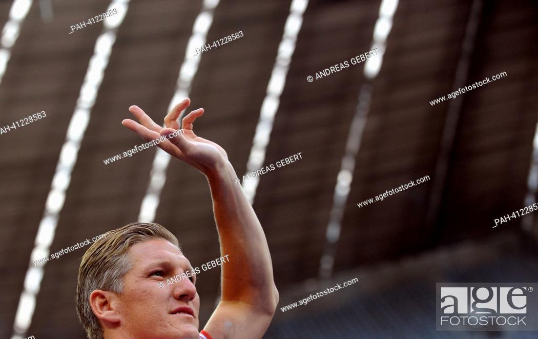 FC Bayern Munich's Bastian Schweinsteiger waves during the