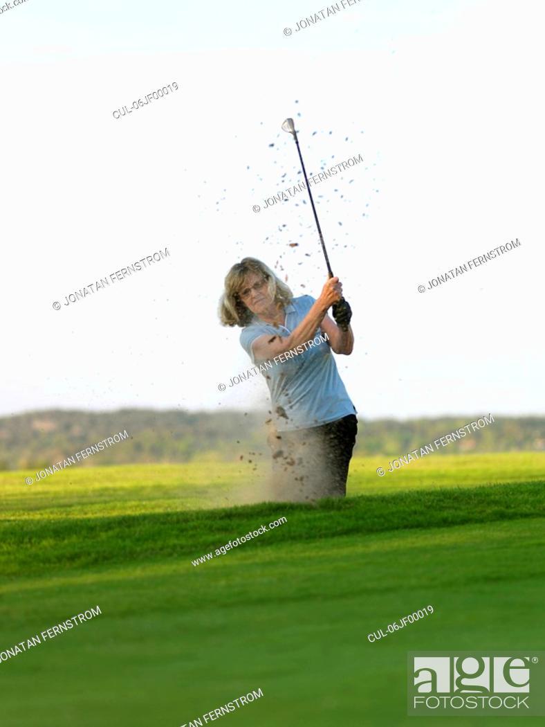 Stock Photo: Woman in golf bunker.
