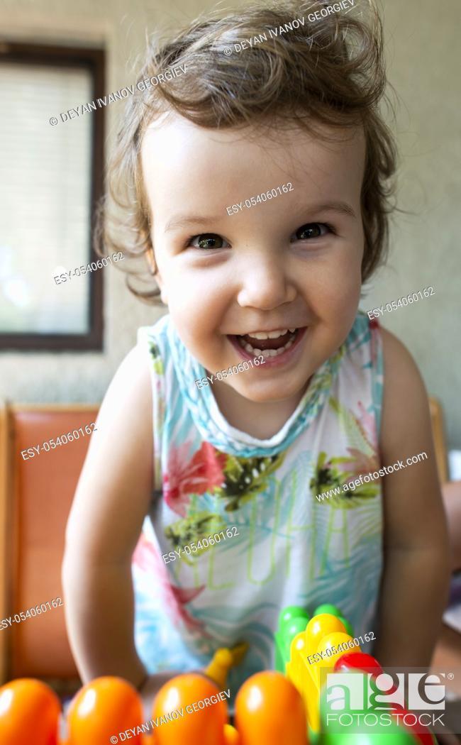 Stock Photo: Smiling little girl. Blocks toy.