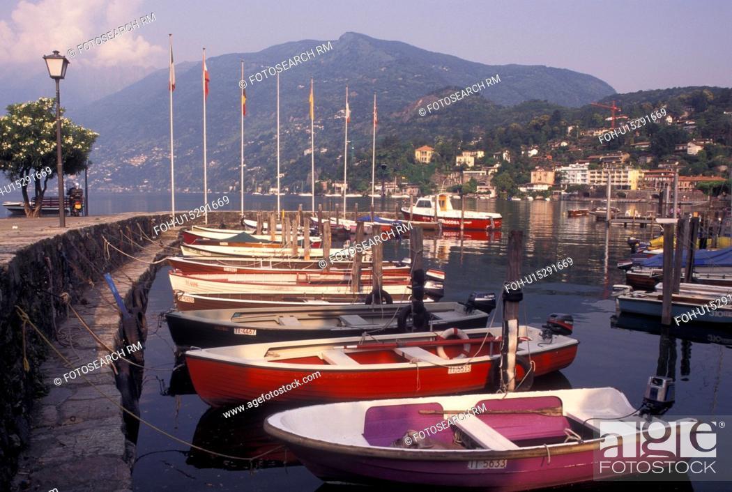 Stock Photo: Switzerland, Ticino, Ascona, Boats docked in the harbor along the lakefront of Lake Maggiore in the city of Ascona.