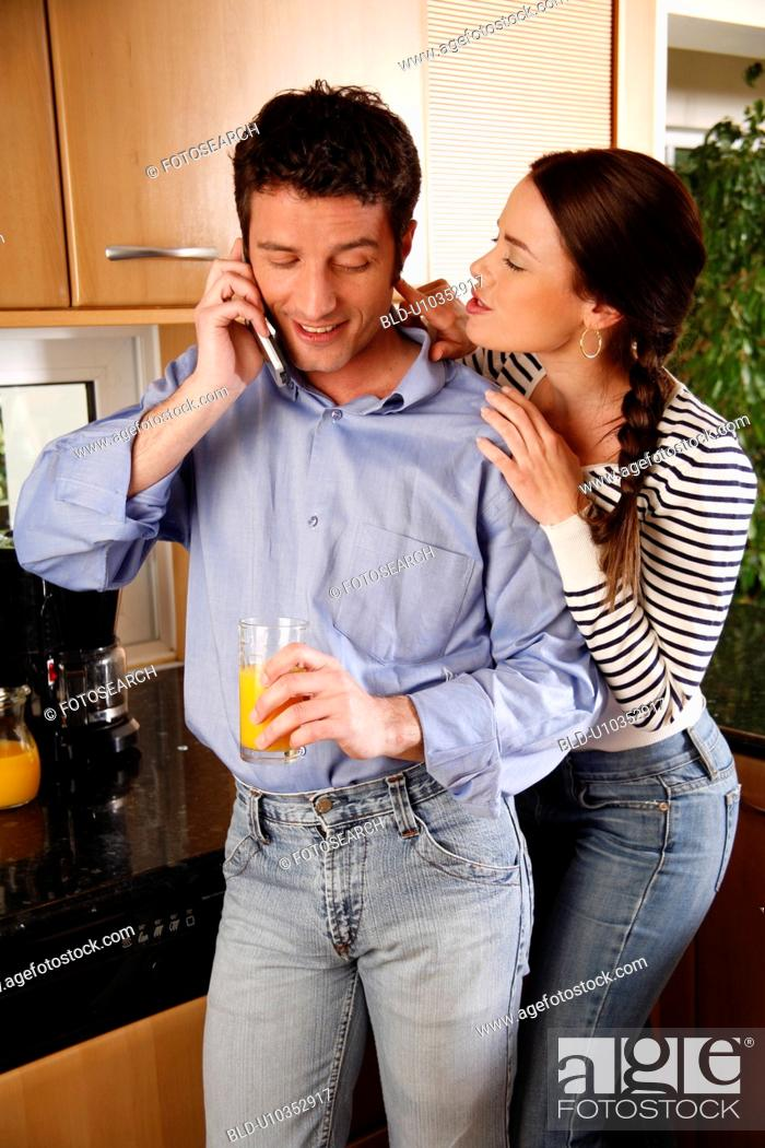 Stock Photo: A young couple in the kitchen.
