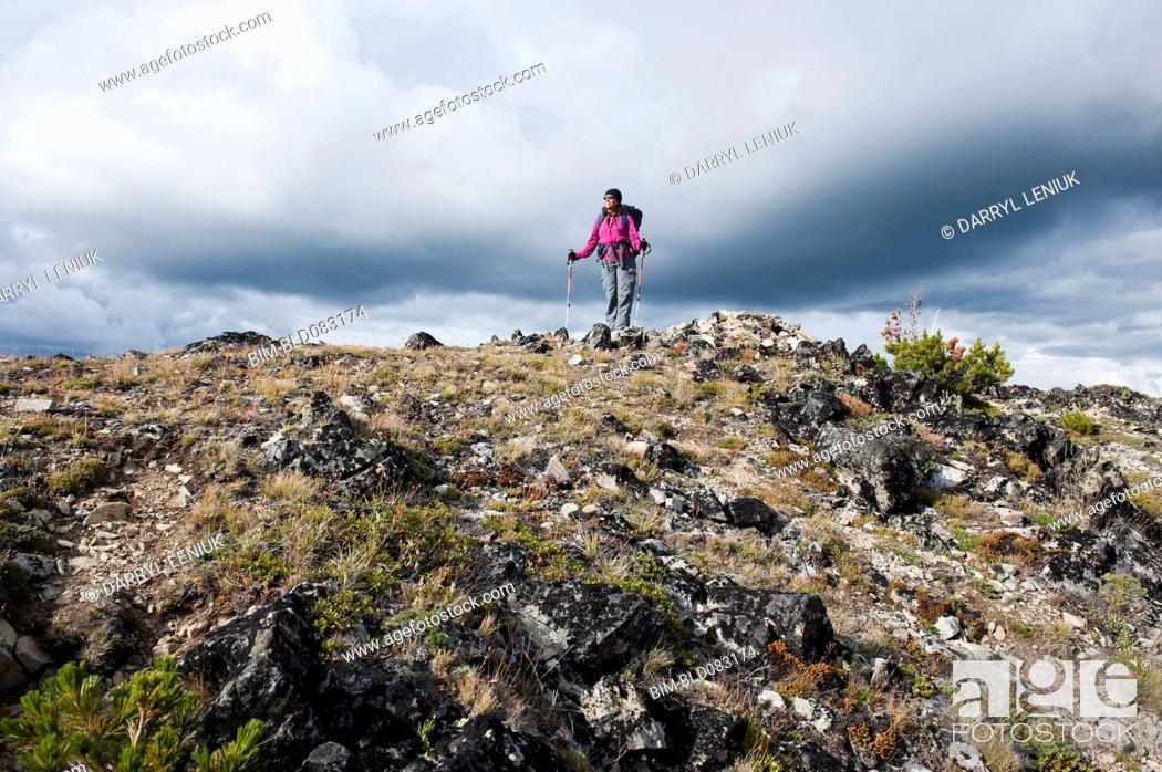 Stock Photo: Hispanic woman hiking on mountain.