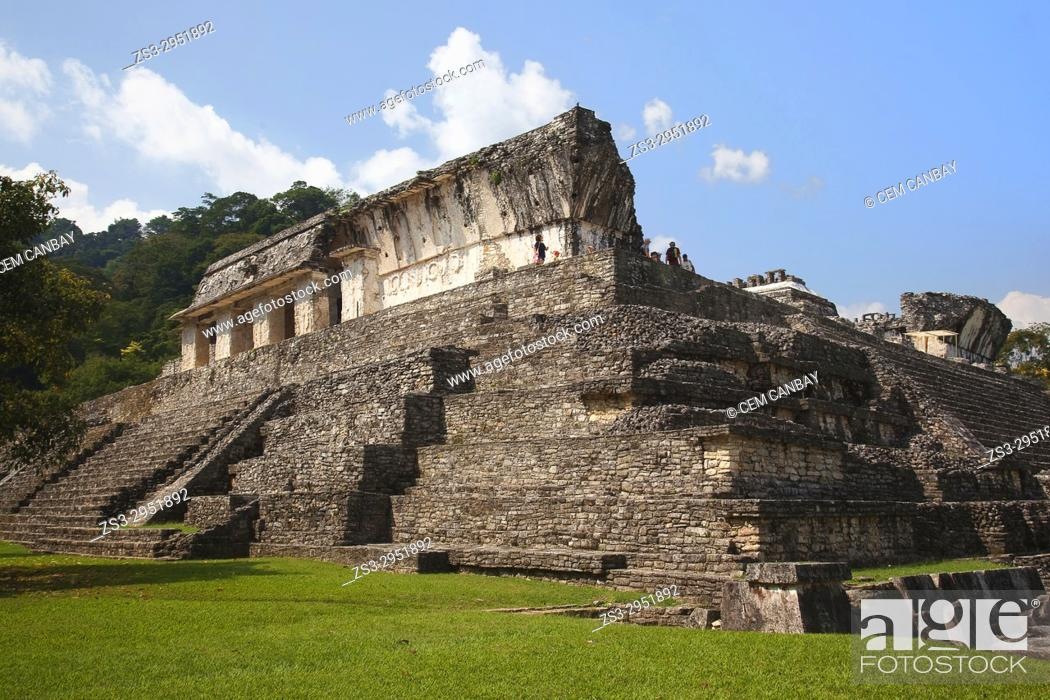 Stock Photo: View to the tourists walking on the Palace in Palenque Archaeological Site, Palenque, Chiapas State, Mexico, Central America.