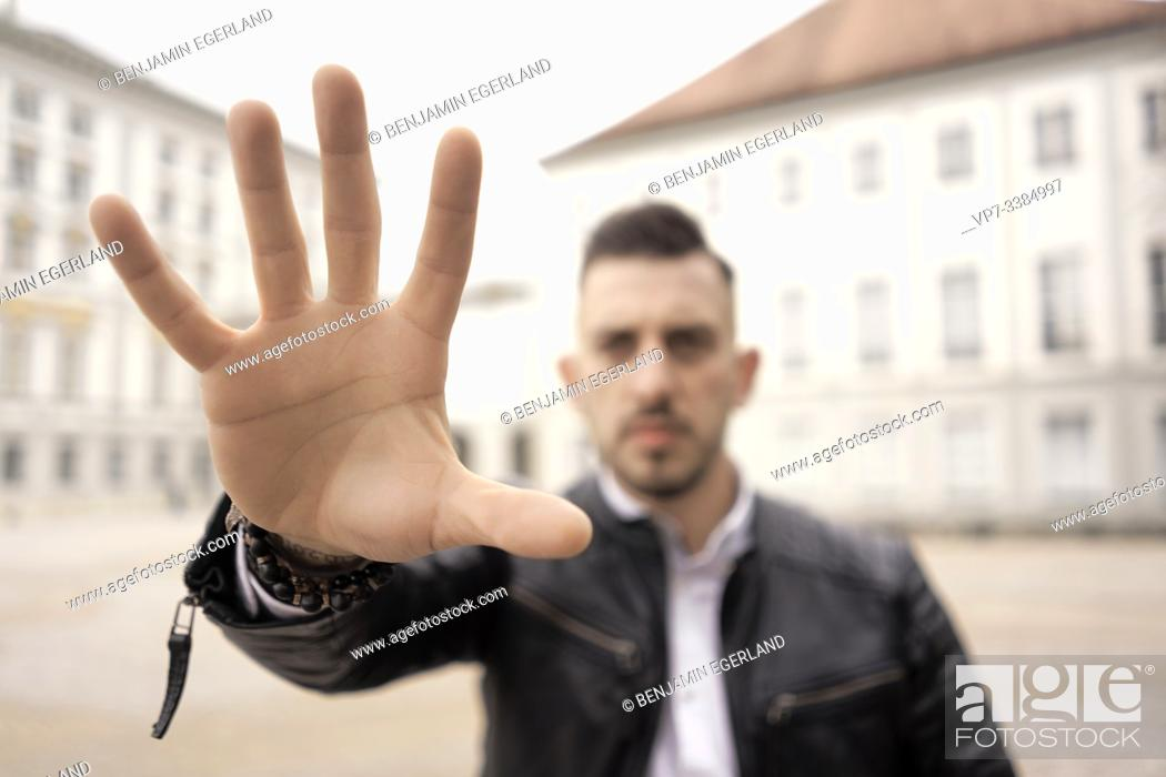 Stock Photo: Man showing reaching hand, in Munich, Germany.